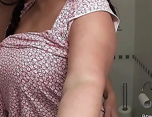 Busty bitch sucks and rides cock in the restroom
