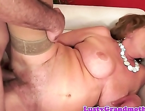 Busty grandma in stockings gets slammed unchanging