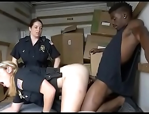 Two Hottie Cops Sharing One Ebon Dink In A Moving Van
