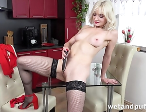 Sexy blonde on every side stockings pleases myself with dildo